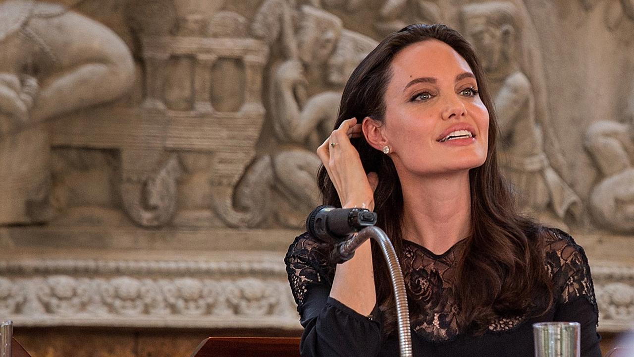 angelina jolie explains how first they killed my father helped her  jolie and ung eventually became friends and it was the author s advice and support that helped the actress make up her mind about adopting a n