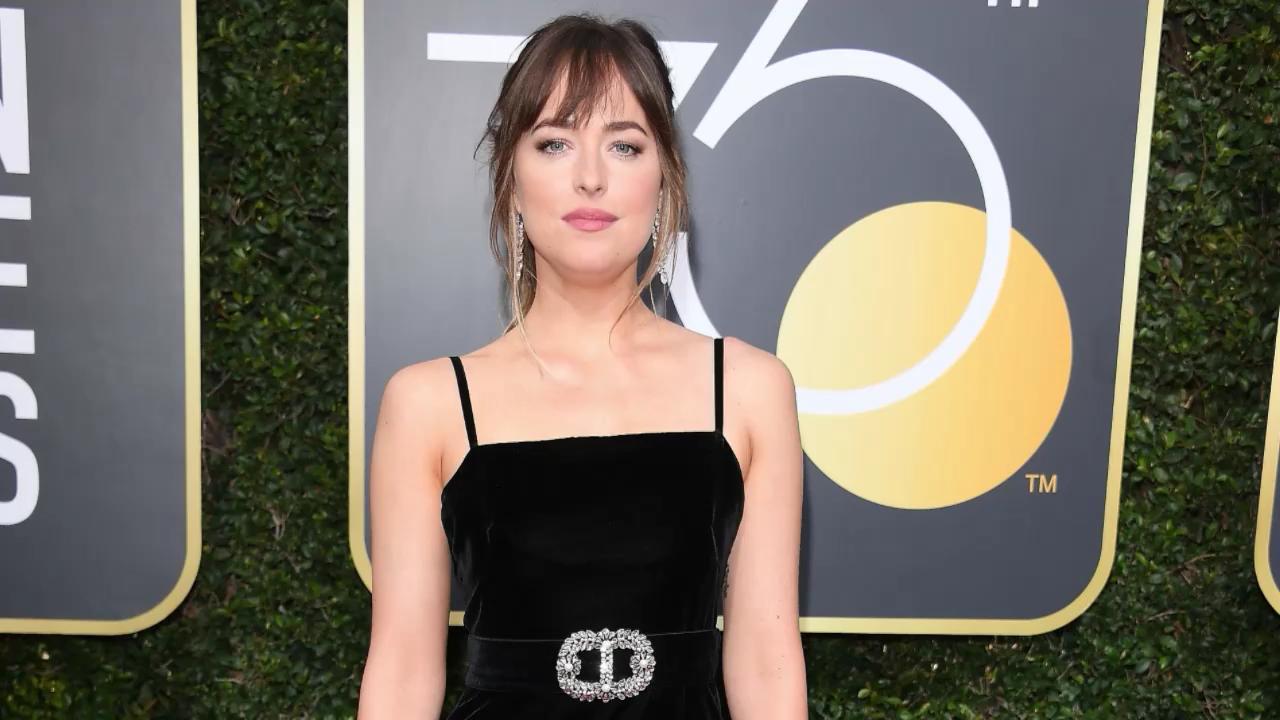 Dakota Johnsons Black Golden Globes Dress Has A Starburst On The Jolie Clothing Long Back